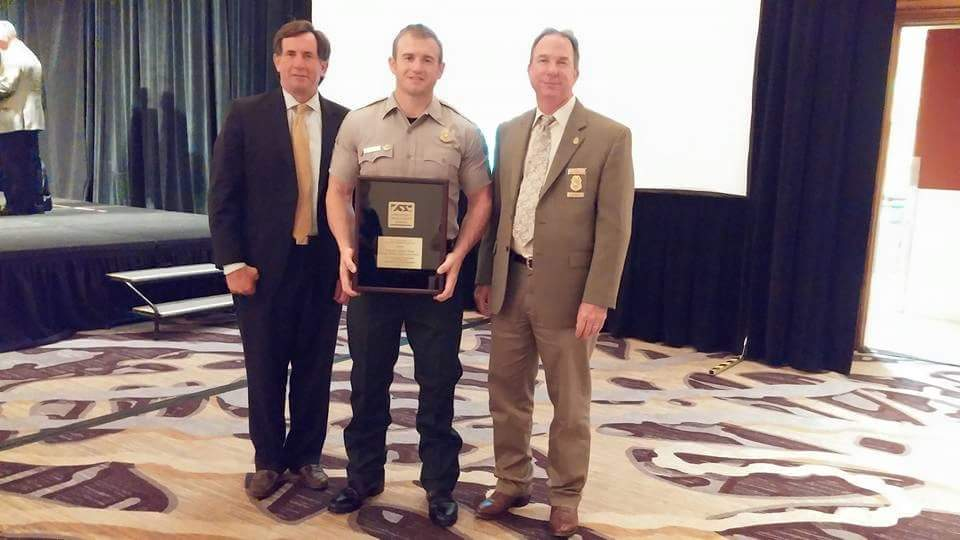 Corporal Greg Wade receiving the Association of Fish and Wildlife Agencies Conservation Law Enforcement Award