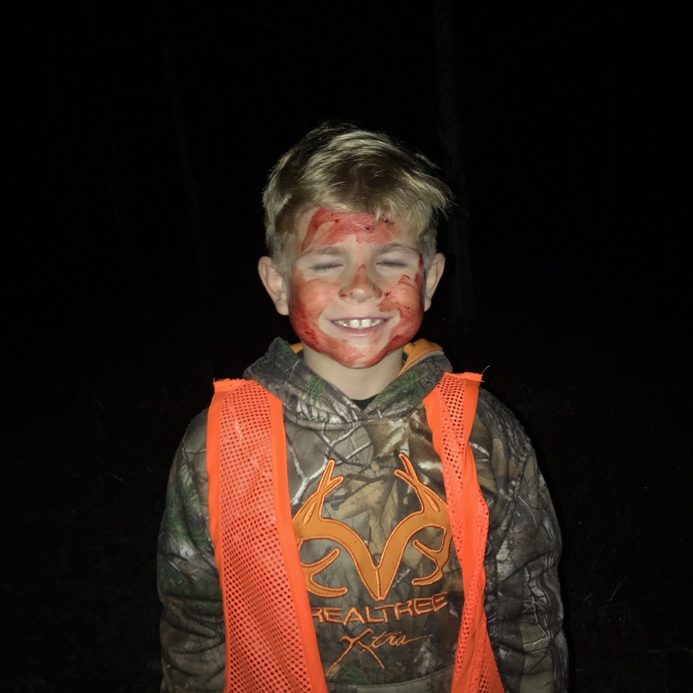 As the deer hunter tradition goes Mason got his face blooded on his first kill